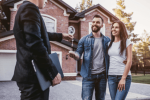 A Realtor Giving The Keys To The Owners Of A New York Home